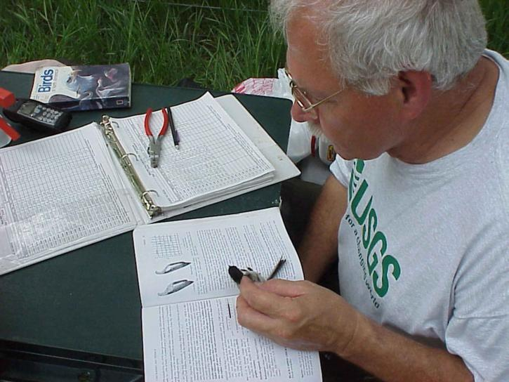man, reading, writing, table