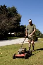 man, mowing, front, lawn, push, lawnmower