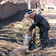 navobod, villager, collects, water pump, steps, home