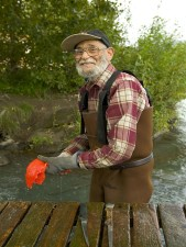 old man, fisherman, cleans, fish