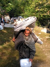 pakistan, villager, carries, supplies, Purri, Pakistan