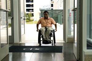 sitting, wheelchair, triggered, mechanized, doors, open