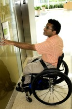 sitting, wheelchair, man, process, hailing, elevator