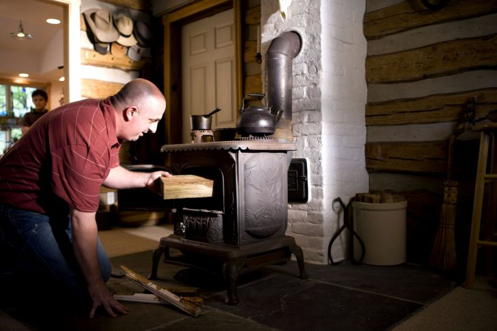 man, place, appears, piece, treated, lumber, stove, fuel