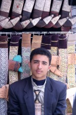 young man, earns, income, selling, traditional, Yemen, knives, open, market