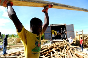 workers, prepare, materials, transitional, shelters, Leogane, Haiti