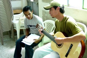 young man, Guatemala, volunteers, teaching, music, youth, center