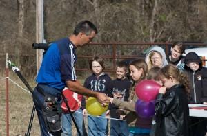 man, helps, girl, tie, balloon