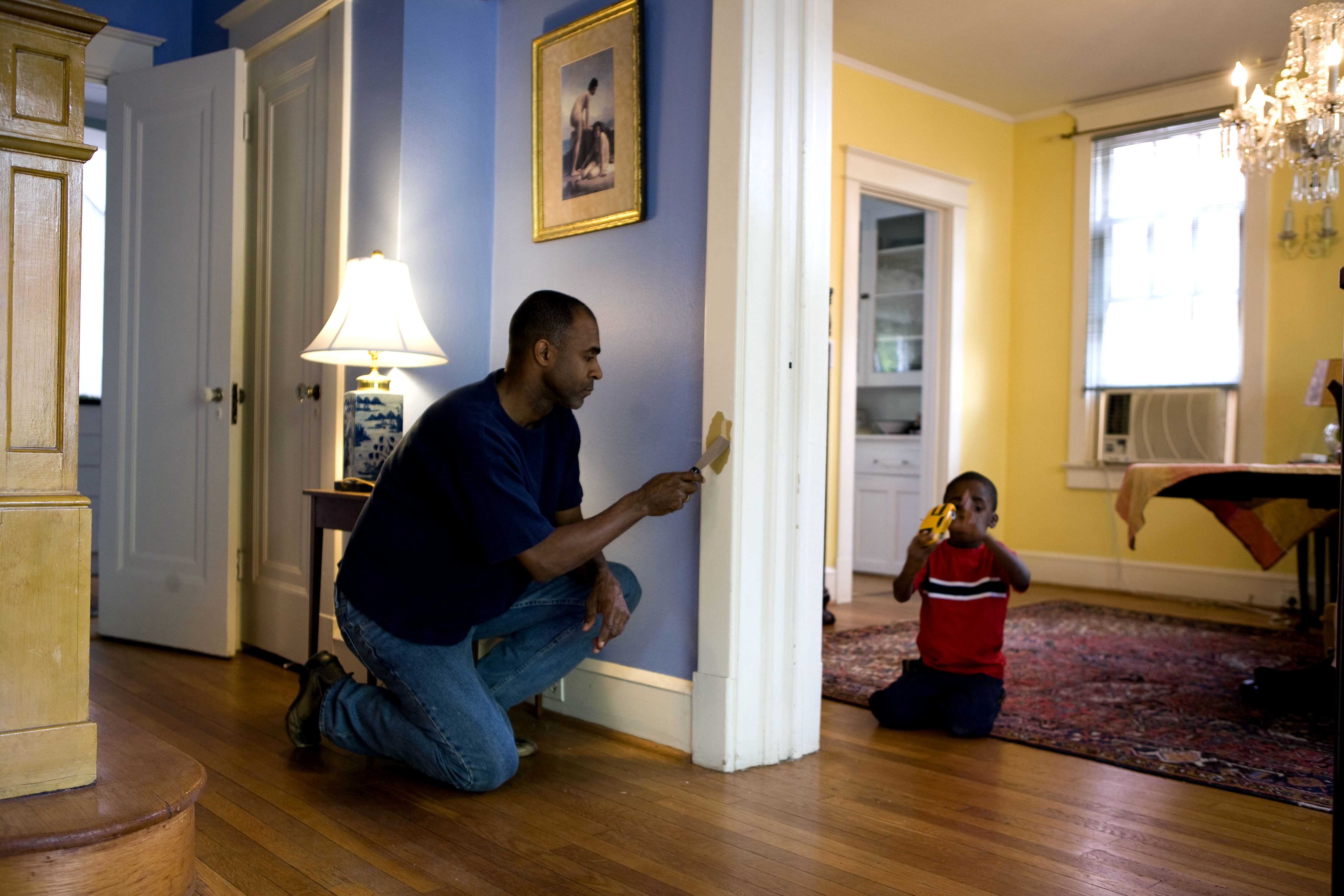 free picture man painting interior door frame home young son. Black Bedroom Furniture Sets. Home Design Ideas