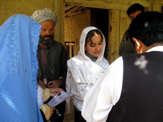 parliamentarian, distributes, certificates, completion, women, participated