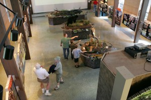 people enjoying, exhibits, museum