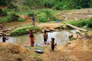 people, Madagascar, girls, washing, river, boy, plays