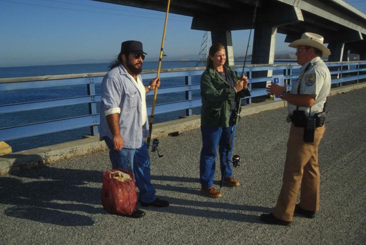 service, law, enforcement, officer, speaks, two, fishermen