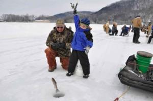 young boy, father, enjoying, winter, ice, fishing