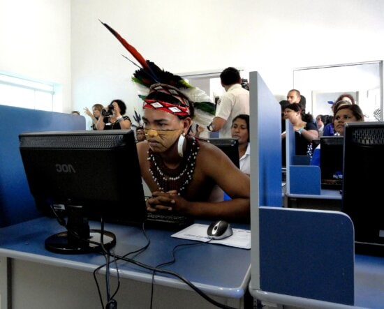 young, brazilian, man, check, computer, center, city, Cabralia, Brazil