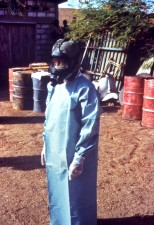 field, technician, demonstrating, protective, clothing, gown, gloves, mask