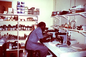 man, sitting, laboratory, bench, microscope