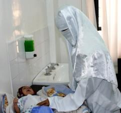 Yemen, doctor, examine, infant