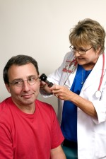 female, clinician, conducting, examination, male, patients, ear, otoscope
