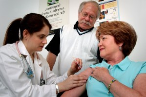 middle, aged, woman, receiving, intramuscular, vaccination, shoulder