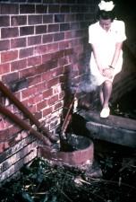 nurse, shown, standing, sewage, pipes, outside, infectious disease, hospital, Johannesburg