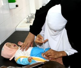 Yemen, female, doctor, vaccinates, child