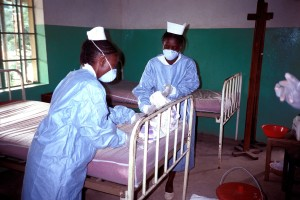 zairian, nurses, wear, protective, clothing, changing, bedding, ebola, isolation, ward