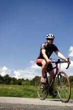bicyclist, streamline, aerodynamically, designed, helmet, sunglasses, skin, tight, riding