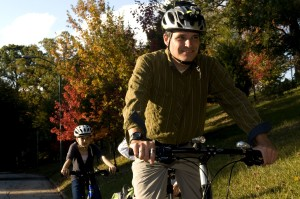 dad, two, young children, bicycle