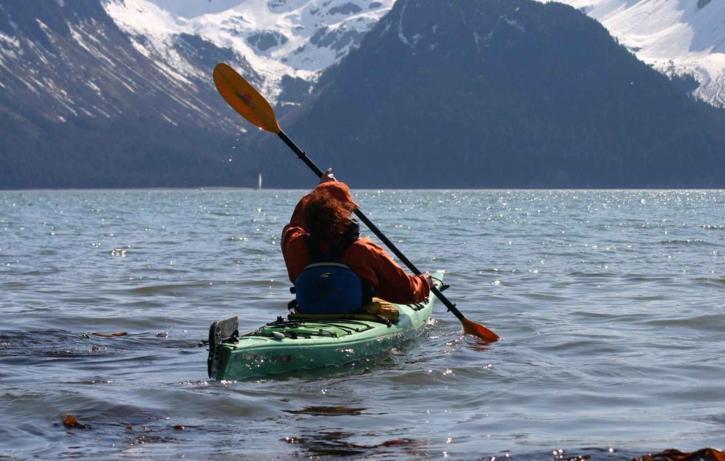 female, kayaker, paddles
