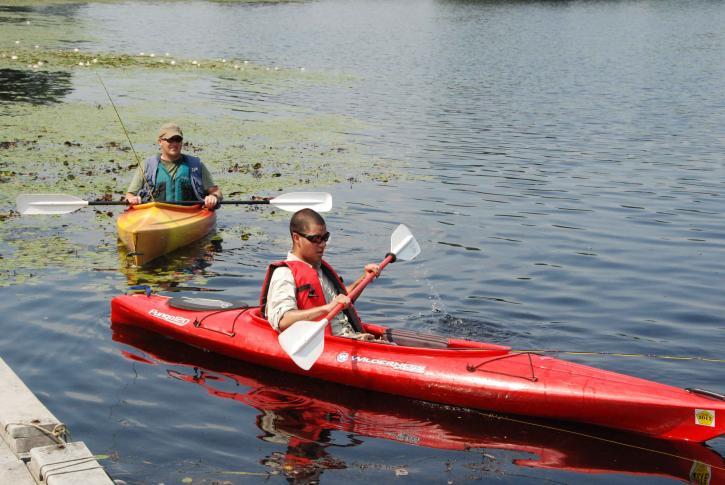 two, young men, relaxing, canoe, ride, quiet, river