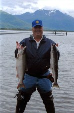 fisherman, holds, fish, silver, coho, salmon