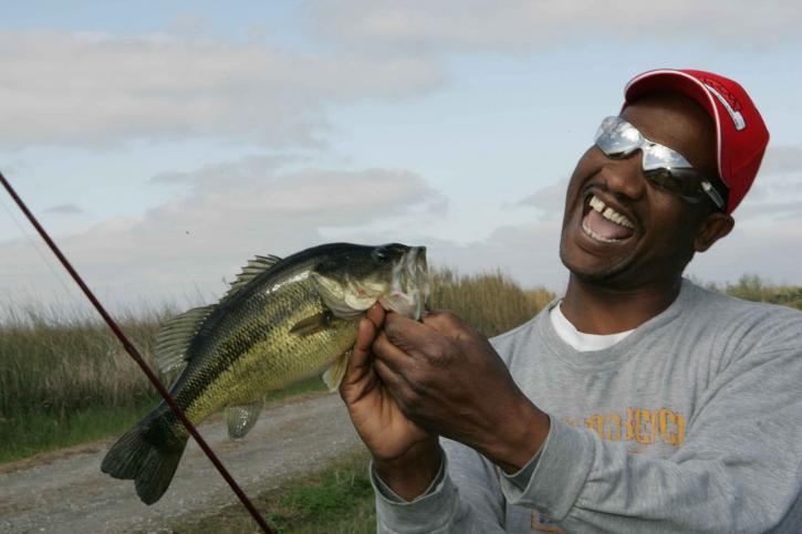 fisherman, proudly, shows, catch, day