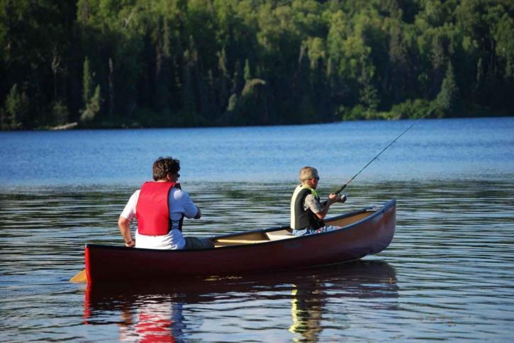 man, child, fish, canoe