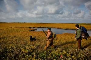 two, men, black dog, hunting
