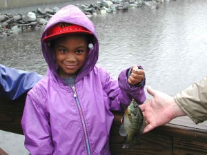 young, African, American, girl, smile, holding, fishing, catch