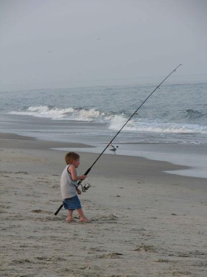jeune garçon, bobines, catch
