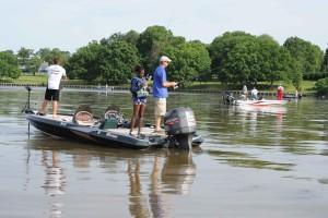 young girl, two, men, fishing boat
