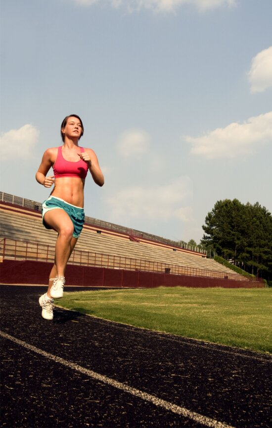 young woman, jogging, high legged technique