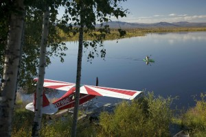 float, plane, lake, man, canoeing