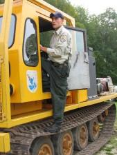 employee, stands, heavy, equipment, vehicle