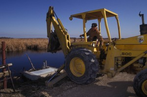 person, tractor, manage, wetland area