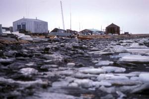 up-close, ice, lake, shore, village, background