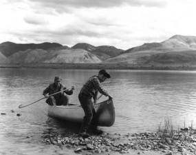 black and white, image, man, boy, coming, ashore, canoe