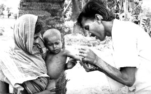 administering, vaccine, young child, mother, held, steady