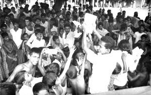 children, reaching, papers, held, overhead