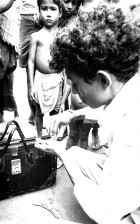volunteer, vaccinator, photographed, checking, vial, smallpox, vaccine