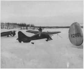 man, stands, airplane, snow, vintage, photo